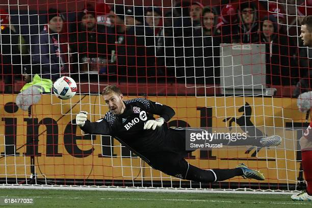 TORONTO ON OCTOBER 26 Toronto FC goalkeeper Clint Irwin makes a diving save as Toronto FC wins their first ever home playoff game 31 against the...