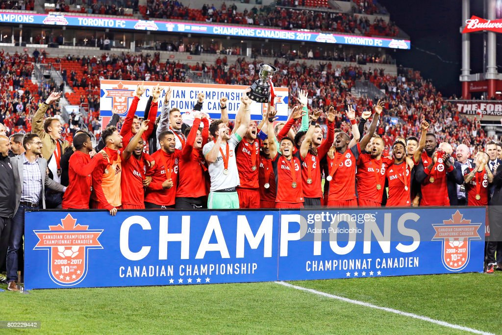 Toronto FC lifts up the Voyageur Cup and celebrates their Canadian Championship after defeating the Montreal Impact 2 - 1 during Leg 2 of the 2017 Canadian Championship and 3 - 2 on aggregate on June 27, 2017 at BMO Field in Toronto, Canada.