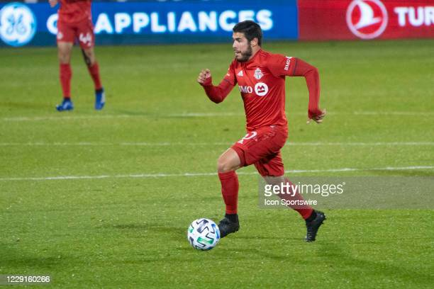 Toronto FC Midfielder Alejandro Pozuelo dribbles the ball up the field during the second half of a Major League Soccer match between the Atlanta...