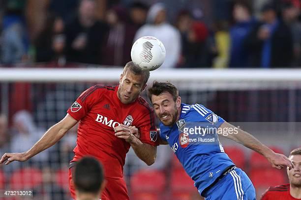 Toronto FC midfielder Benoit Cheyrou goes up against Montreal Impact midfielder Eric Alexander as Toronto FC plays Montreal Impact in the Semi-Final...