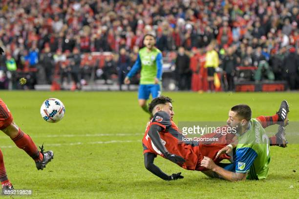 Toronto FC Midfielder Jonathan Osorio is brought down by Seattle Sounders Midfielder Clint Dempsey during the MLS Cup Final played between the...
