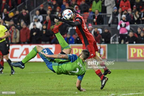 Toronto FC Midfielder Jonathan Osorio tries to head the ball as Seattle Sounders Forward Clint Dempsey tries to scissor kick during the MLS CUP...