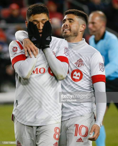 Toronto FC midfielder Marco Delgado is beside himself after a missed play as Toronto FC midfielder Alejandro Pozuelo comes to console him Toronto FC...