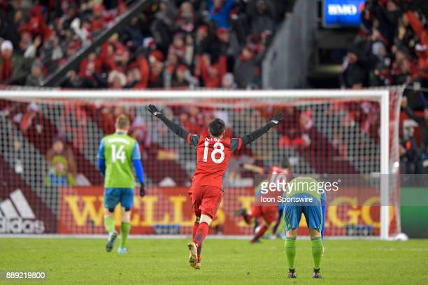 Toronto FC Midfielder Marco Delgado joins Sebastian Giovinco in celebrating the team's first goal during the MLS Cup Final played between the Seattle...