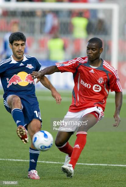 Toronto FC midfielder Maurice Edu fight for control with Red Bulls midfielder Claudio Reyna during the home match against the New York Red Bulls in...