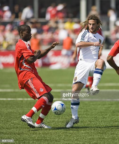 Toronto FC midfielder Maurice Edu tries to keep the ball away from Real Salt Lake midfielder Kyle Beckerman during their game on April 19, 2008 at...