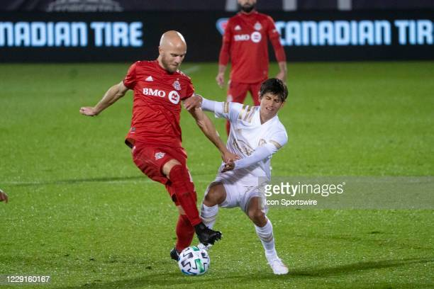 Toronto FC Midfielder Michael Bradley and Atlanta United FC Midfielder Jurgen Damm battle for the ball during the second half of a Major League...