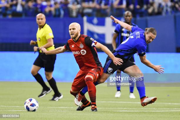 Toronto FC midfielder Michael Bradley collides with Montreal Impact midfielder Samuel Piette while in possession of the ball during the Toronto FC...