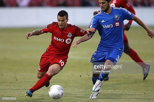 TORONTO ON MAY 13 Toronto FC midfielder Sebastian Giovinco tries to get past Montreal Impact defender Eric Miller as Toronto FC beats the Montreal...