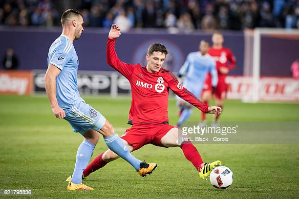 Toronto FC Midfielder Will Johnson tries to keep control against NYCFC defender during the Soccer 2016 Major League Soccer 2nd Leg of Eastern Region...