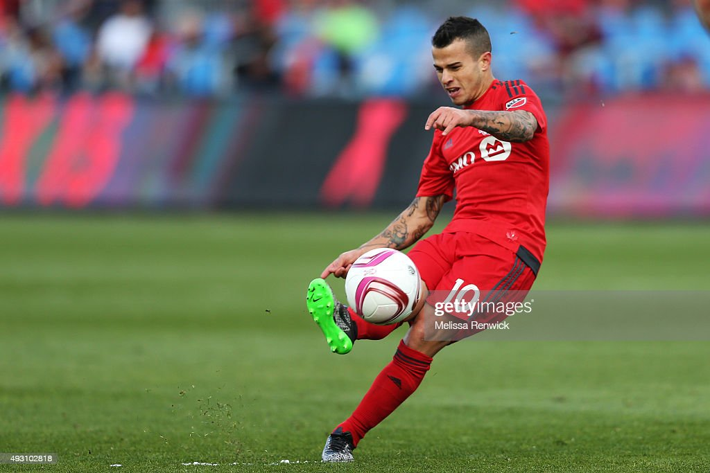 TORONTO, ON - OCTOBER 15 - Toronto FC, Sebastian Giovinco, hits a direct free kick during the second half action of MLS season play between Toronto FC and Columbus Crew SC at the BMO Field in Toronto.