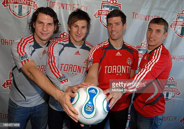 Toronto FC signing Adam Braz with Chris Pozniak and Marco Reda with Ronnie O'Brien hands on the ballalso coach Mo Johnston at press conf table At the...