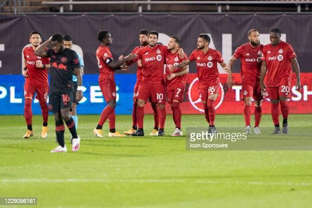 Toronto FC teamates congratulate Toronto FC Forward Ayo Akinola for scoring a goal during the first half of a Major League Soccer match between the...