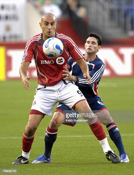 Toronto FC's Danny Dichio holds back New England Revolution's Jay heaps during MLS action at Gillette Stadium in Foxborough, MA, June 23, 2007.