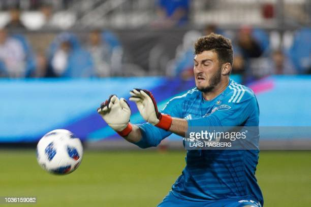 Toronto FC's US goalkeeper Alex Bono makes a save during the 1st half of the Campeones Cup against Tigres UANL at BMO Field in Toronto Ontario...