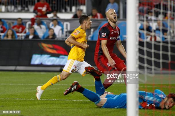 Toronto FC's US midfielder Michael Bradley reacts as Tigres UANL's Mexican midfielder Jurgen Damm scores the first goal against Totonto FC's US...