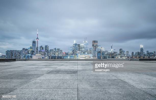toronto financial district with town square against cloudy sky - square stock pictures, royalty-free photos & images