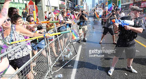 Toronto fireman takes a direct hit during the WorldPride 2014 parade hosted by Pride Toronto along Yonge Street in Toronto June 29 2014