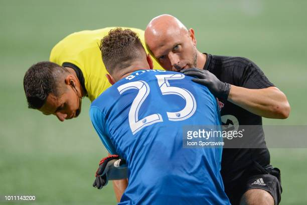 Toronto goalkeeper Alex Bono is checked by the trainer during the match between Atlanta United and Toronto FC on August 4th 2018 at MercedesBenz...