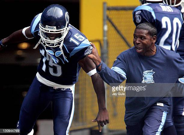 Toronto Head Coach Mike Pinball Clemons tries to get Tony Miles pumped for today's game on September 10 2005 at the Rogers Centre in Toronto Canada