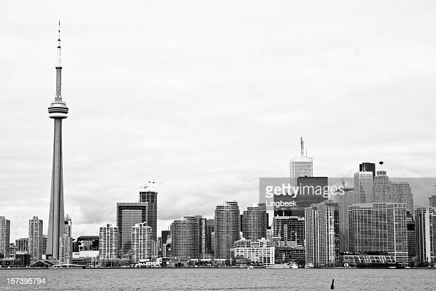 toronto in storm clouds - cn tower stock pictures, royalty-free photos & images