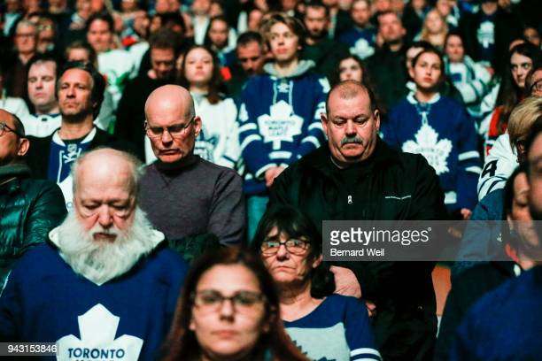 TORONTO ON APRIL 7 Toronto Maple Leaf fans bow their heads in a moment of silence to for the victims of hockey team bus tragedy the day before A bus...