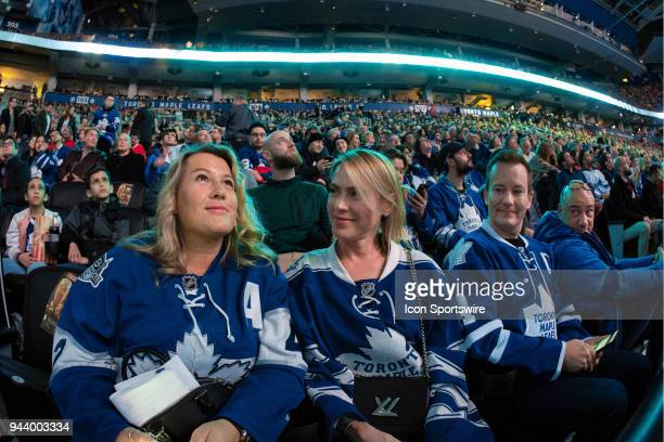 Toronto Maple Leaf fans watch the scoreboard presentation before the final NHL 2018 regularseason game between the Montreal Canadiens and the Toronto...