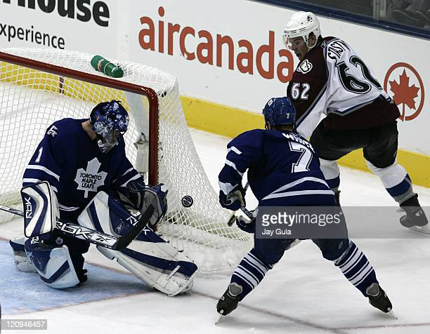 Toronto Maple Leaf goaltender Andrew Raycroft makes a save on Colorado's Paul Stastny as Toronto's Ian White looks on in NHL action vs the Colorado...