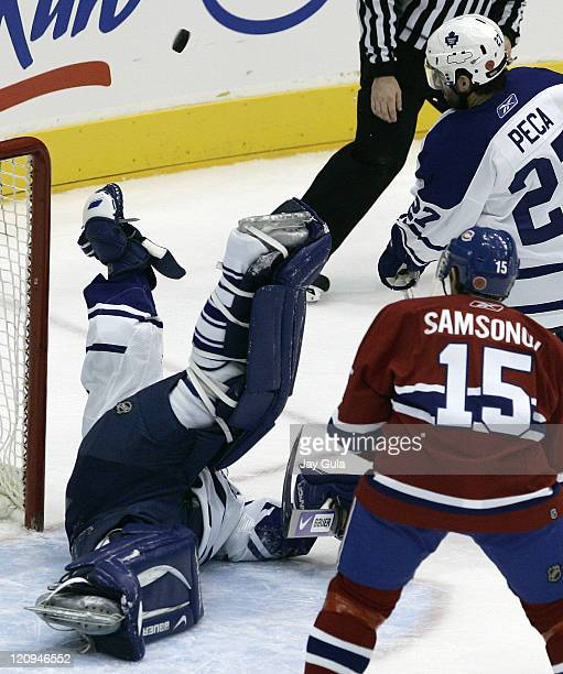 Toronto Maple Leaf goaltender JSAubin makes an acrobatic pad save while Toronto's Michael Peca and Montreal's Sergei Samsonov look on in action vs...