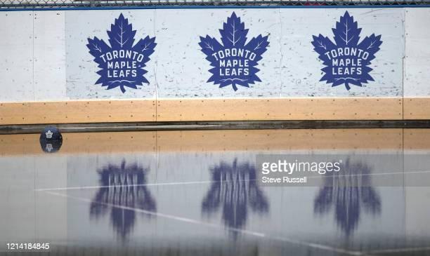 Toronto Maple Leaf hat sits in the water of an outdoor rink in Regent Park as we face 60 days of the NHL season on pause Even as Ontario begins to...