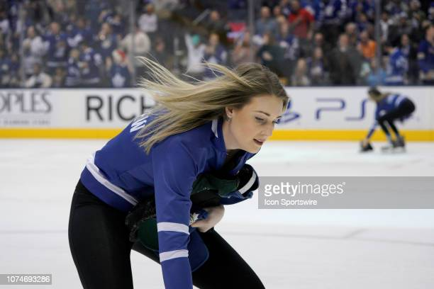 Toronto Maple Leaf ice girls remove hats thrown on the by fans ice fore and aft after believing Toronto Maple Leafs Right Wing Mitchell Marner had...