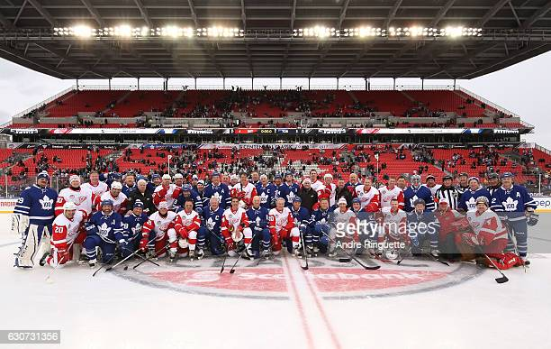 Toronto Maple Leafs alumni and Detroit Red Wings alumni pose for a group photo during the 2017 Rogers NHL Centennial Classic Alumni Game at...