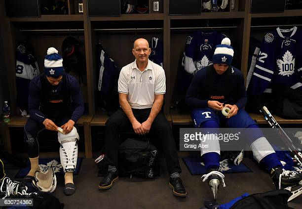 Toronto Maple Leafs alumni Bob McGill sits with Toronto Maple Leafs Mitch Marner and Auston Matthews prior to the 2017 Rogers NHL Centennial Classic...
