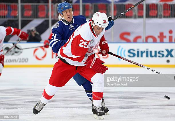 Toronto Maple Leafs alumni Borje Salming plays against Detroit Red Wings alumni Darren McCarty during the 2017 Rogers NHL Centennial Classic Alumni...