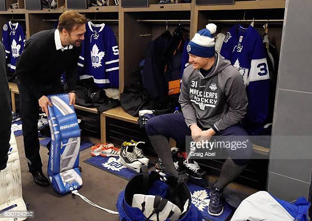 Toronto Maple Leafs alumni Curtis Joseph talks with Toronto Maple Leafs goaltender Frederik Andersen prior to the 2017 Rogers NHL Centennial Classic...