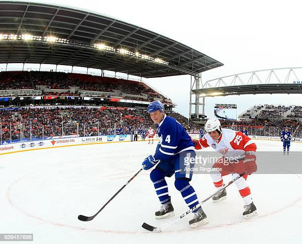 Toronto Maple Leafs alumni Dave Ellet battles for a loose puck with Detroit Red Wings alumni Darren McCarty during the 2017 Rogers NHL Centennial...