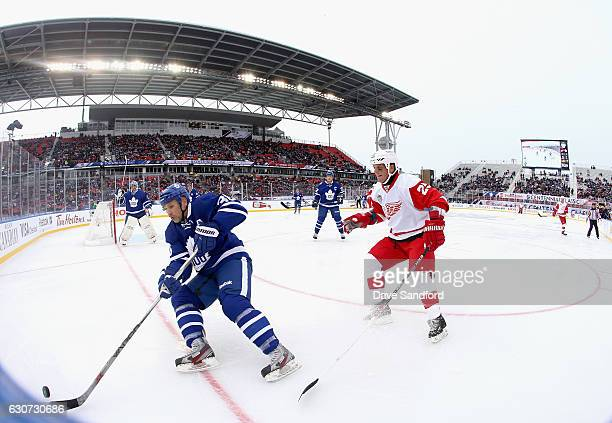 Toronto Maple Leafs alumni Dmitri Yushkevich plays against Detroit Red Wings alumni Darren McCarty in the 2017 Rogers NHL Centennial Classic Alumni...