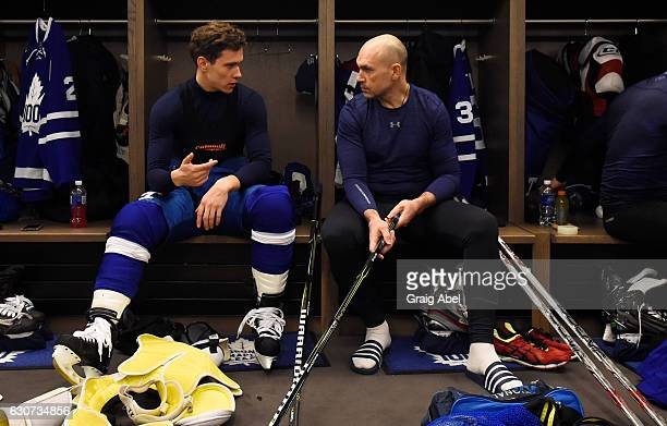 Toronto Maple Leafs alumni Dmitri Yushkevich speaks with Toronto Maple Leafs Nikita Zaitsev before the 2017 Rogers NHL Centennial Classic between the...