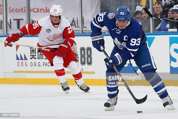 Toronto Maple Leafs alumni Doug Gilmour skates against Detroit Red Wings alumni Darren McCarty at the 2017 Rogers NHL Centennial Classic Alumni game...