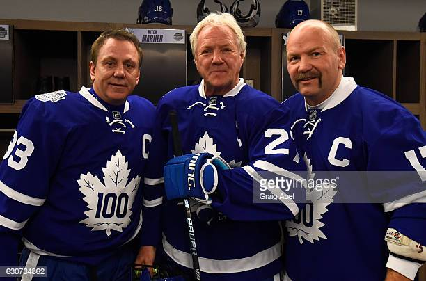 Toronto Maple Leafs alumni Doug Gilmour stands with teammates alumni Darryl Sittler and alumni Wendel Clark the 2017 Rogers NHL Centennial Classic...