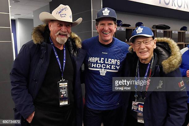 Toronto Maple Leafs alumni Eddie Shack and Johnny Bower pose with Toronto Maple Leafs head coach Mike Babcock before the 2017 Rogers NHL Centennial...