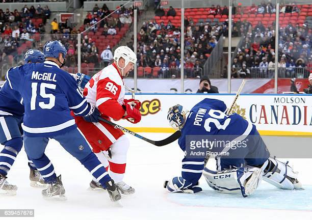 Toronto Maple Leafs alumni Felix Potvin makes a save off a shot from Detroit Red Wings alumni Tomas Holmstrom during the 2017 Rogers NHL Centennial...