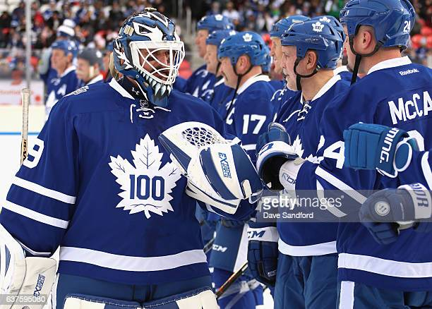 Toronto Maple Leafs alumni goaltender Felix Potvin is greeted by his team before playing in the 2017 Rogers NHL Centennial Classic Alumni Game...
