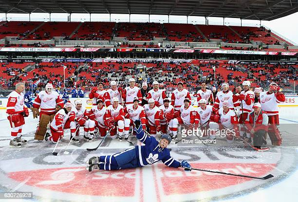 Toronto Maple Leafs alumni Lanny McDonald slides across the ice in front of the Detroit Red Wings alumni team before the 2017 Rogers NHL Centennial...