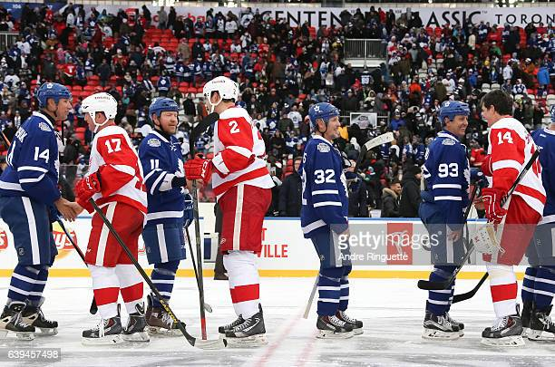 Toronto Maple Leafs alumni shake hands with Detroit Red Wings alumni during the 2017 Rogers NHL Centennial Classic Alumni Game at Exhibition Stadium...