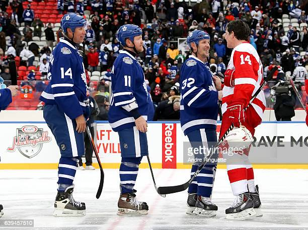 Toronto Maple Leafs alumni Steve Thomas shakes hands with Detroit Red Wings alumni Brendan Shanahan during the 2017 Rogers NHL Centennial Classic...