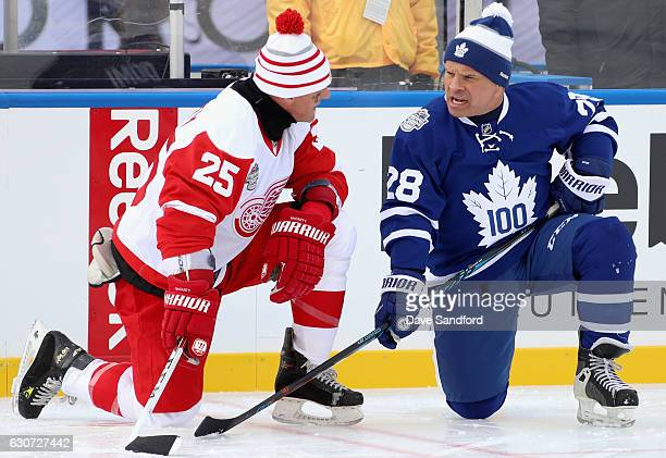 Toronto Maple Leafs alumni Tie Domi greets Detroit Red Wings alumni Darren McCarty before playing in the 2017 Rogers NHL Centennial Classic Alumni...