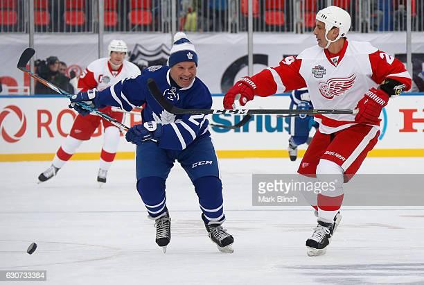 Toronto Maple Leafs alumni Tie Domi skates against Detroit Red Wings alumni Chris Chelios during the 2017 Rogers NHL Centennial Classic Alumni game...