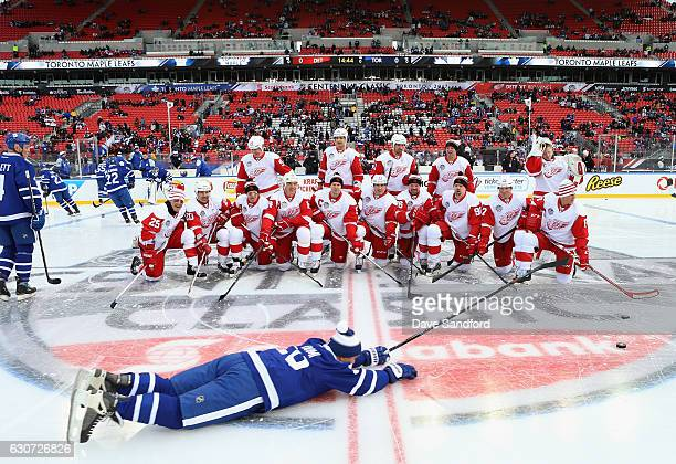 Toronto Maple Leafs alumni Tie Domi slides across the ice in front of the Detroit Red Wings alumni team before the 2017 Rogers NHL Centennial Classic...