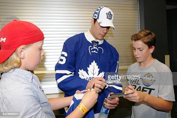 Toronto Maple Leafs Auston Matthews signs autographs after being selected first overall during round one of the 2016 NHL Draft on June 24 2016 in...